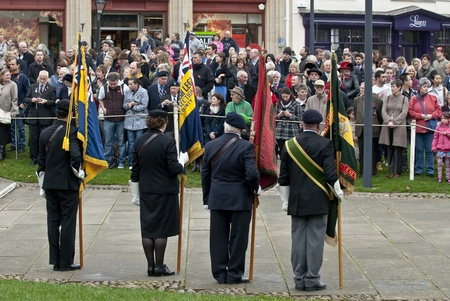 Flag barers from the Royal British Legion stand in front of crowd during the rememberance Day service at Exeter Cathedral on Exeter Cathedral Green.