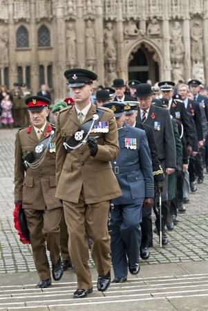 Officers from the army, airforce and navy march from Exeter Cathedral during the rememberance Day service at Exeter Cathedral on Exeter Cathedral Green.