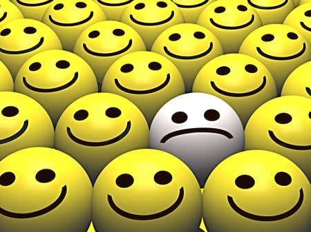 A sad smiley stands out from the crowd of happy smileys Stock Photo