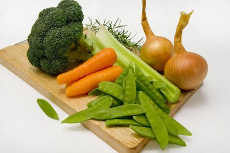 Vegetables on a chopping board ready to be prepared