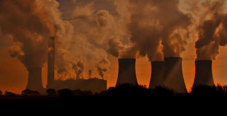 A power station at sunset.  Stock Photo