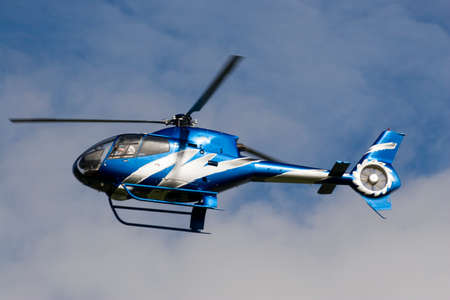 airfoil: A blue helicopter flying in very low