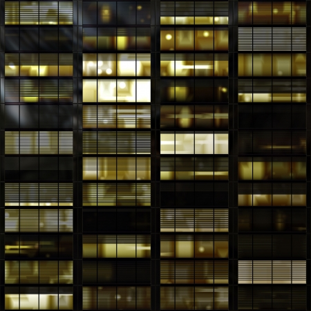 Windows in a high rise towerblock or skyscraper at night Stock Photo - 2460397
