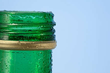 very cold: A very cold green glass bottle opened. Stock Photo