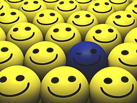 A winking blue smiley stands out from the crowd Stock Photo