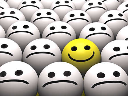 faces happy to sad: A happy smiley stands out from the crowd Stock Photo