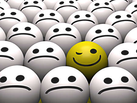 A winking yellow smiley stands out from the crowd Stock Photo