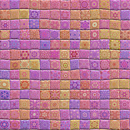 An illustration of a hand crafted quilt made from patterned squares