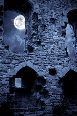 horrors: A very spooky Halloween castle in the moonlight Stock Photo
