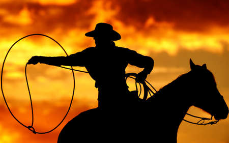 Silhouette of Lassoing Cowboy