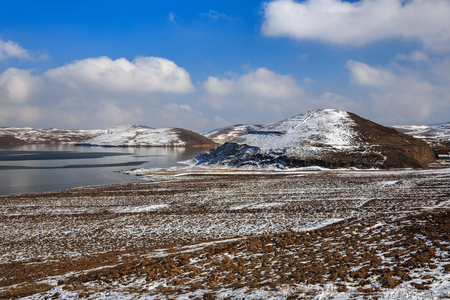 Winter Scenery in Dashanbao Black-necked Crane National Nature Reserve. Zhaotong, Zhaoyang District, Yunnan Province, China. Blue Sky, Snow Covered Landscape, Frozen Winter Wonderland. Orange Soil