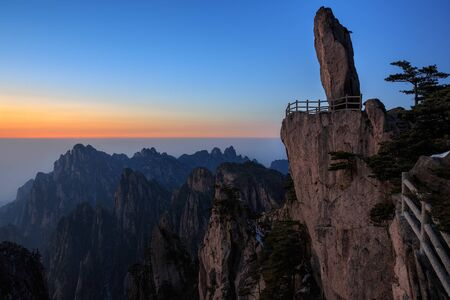 Huangshan China, Flying Over Rock - Feilai Stone, National Park, Anhui Province, Mountain Peak, Viewing Platform, Sunset with Beautiful Horizon, Jagged Cliffs, Chinese Mountain Landscape 写真素材