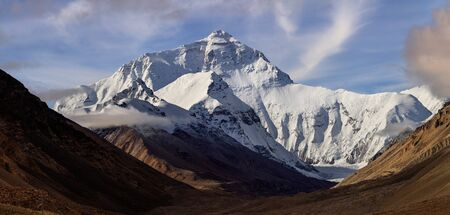 Mount Everest as seen from Base Camp in Tibet. Tallest mountain on earth, mountaineering destination. Adventure, trekking, tourism. Border between Tibet and Nepal. Panoramic View with Clear Blue Skies