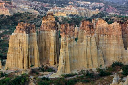 Earth Forest of Yuanmou in Yunnan Province, China - Exotic earth and sandstone formations. Naturally formed pillars of rock and clay with unique erosion patterns. China Travel