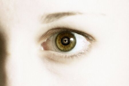 Close up shot of a girls eye with eye in reflection Stock Photo