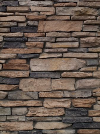 Stacked stone details with multiple colors and sizes of rocks Stock Photo