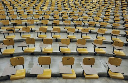 A large amount of empty seats with tables in a lecture hall Stock Photo - 5373209