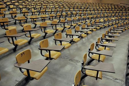 A large amount of empty seats with tables in a lecture hall Stock Photo - 5373211
