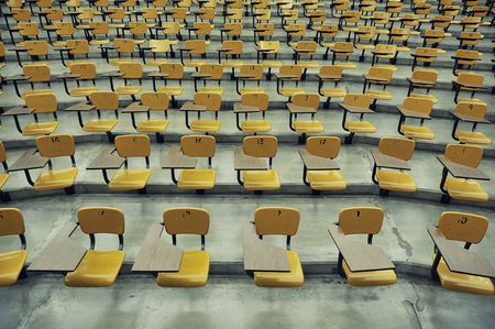 A large amount of empty seats with tables in a lecture hall Stock Photo - 5373210