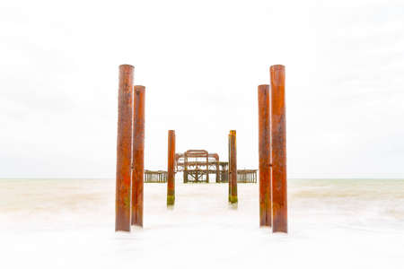 HIGH KEY Deliberately Over Exposed Atmospheric and Moody Long Exposure Photograph of the Ruins of the old Brighton West Pier at Brighton, East Sussex, England, UK. 스톡 콘텐츠