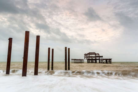 Atmospheric and Moody Long Exposure Photograph of the Ruins of the old Brighton West Pier at Brighton, East Sussex, England, UK.