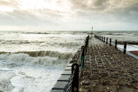 Atmospheric and Moody Photograph of Stone Pier at Brighton, East Sussex, England, UK .