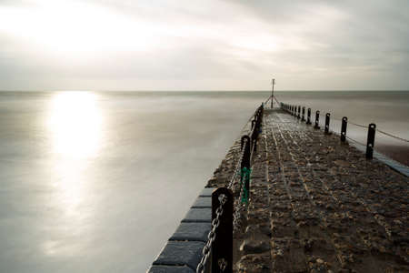 Atmospheric and Moody Long Exposure Photograph of Stone Pier at Brighton, East Sussex, England, UK with copy space.