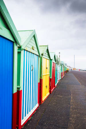 Colourful Beach Huts on Dull, Drab, Cloudy Winters Day in Brighton, West Sussex, England, UK.