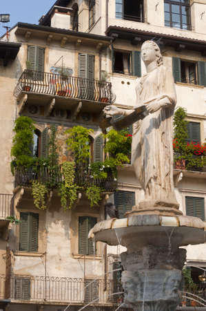 Verona (Veneto, Italy), Piazza Erbe, historic square with Roman fountain (380) photo