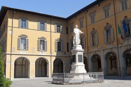 portico: Prato (Tuscany, Italy), historic square with statue of Francesco Di Marco Datini, made by Antonio Garella at the end of 19th century. Stock Photo