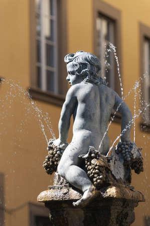 putto: Prato (Tuscany, Italy), ancient fountain in Piazza del Comune Stock Photo