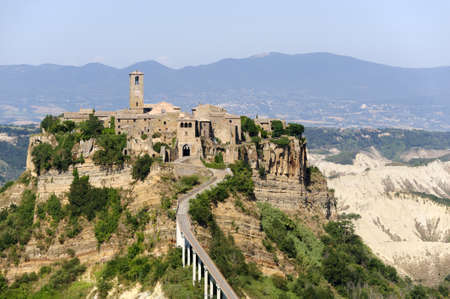 Civita di Bagnoregio (Viterbo, Lazio, Italy(, the historic village surrounded by calanques photo
