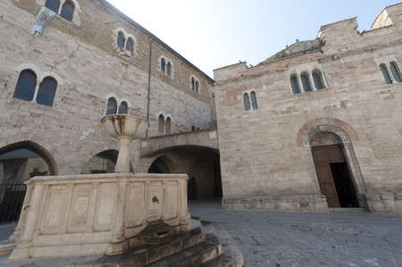 bevagna: Historic Silvestri square in Bevagna (Perugia, Umbria, Italy), with church and fountain Stock Photo