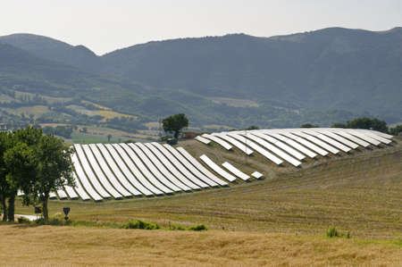 Landscape in Marches (Italy) with solar panels at summer photo