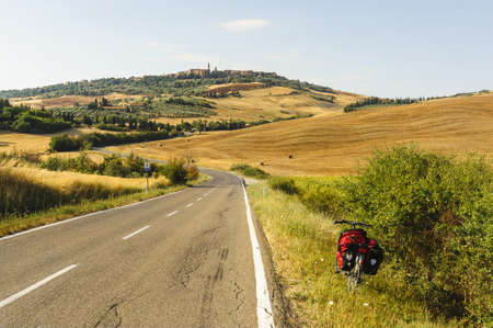 Typical landscape in Val dOrcia (Siena, Tuscany, Italy) at summer. The road to Pienza with a bicycle