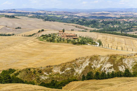 Typical landscape in Val dOrcia (Siena, Tuscany, Italy) at summer. Old farm photo
