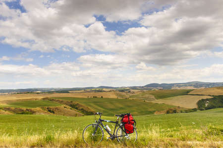 Typical landscape in Val dOrcia (Siena, Tuscany, Italy) at summer, with bicycle photo