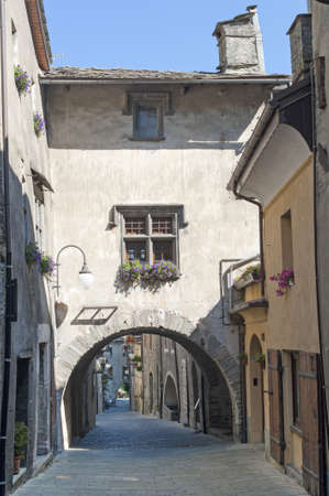 bard: Bard  Aosta, Italy  - Street of the medieval village with arch and flowered window