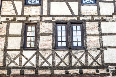 Chalamont (Ain, Rhone-Alpes, France) - Windows of a half-timbered house Stock Photo - 13663913