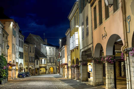 Louhans  Saone-et-Loire, Burgundy, France  - The main street with portico at night