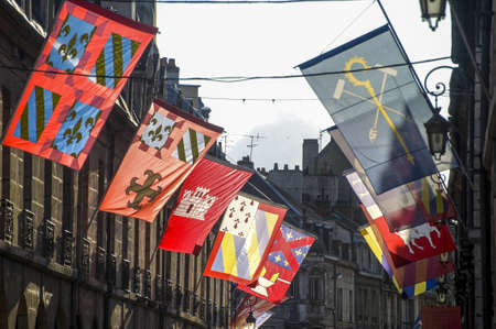 Dijon (Cote-dOr, Burgundy, France) - Exterior of ancient buildings with flags Stock Photo