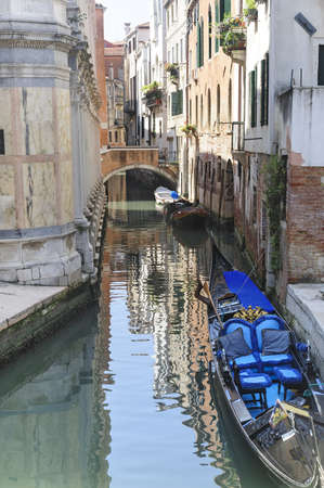 Venice (Venezia, Veneto, Italy), a typical canal with bridge and gondola Stock Photo - 15081515