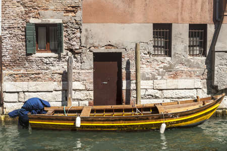 Venice (Venezia, Veneto, Italy), old typical building on a canal and boat Stock Photo - 15257862