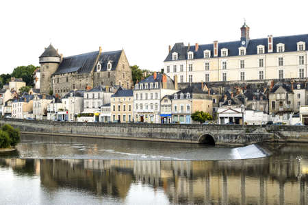 Laval (Mayenne, Pays de la Loire, France) - Ancient buildings on the river at evening photo