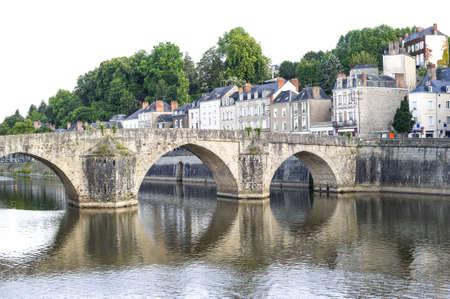 pays: Laval (Mayenne, Pays de la Loire, France) - Ancient buildings and bridge on the river at evening