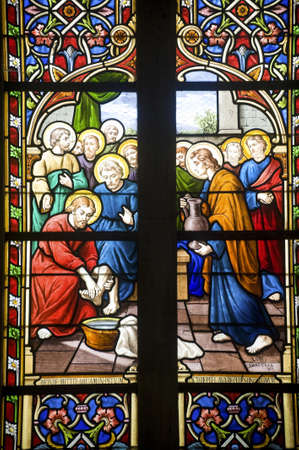 feet washing: Gace (Orne, Basse Normandie, France) - Interior of the Saint-Pierre church, in new gothic style: stained glass Editorial