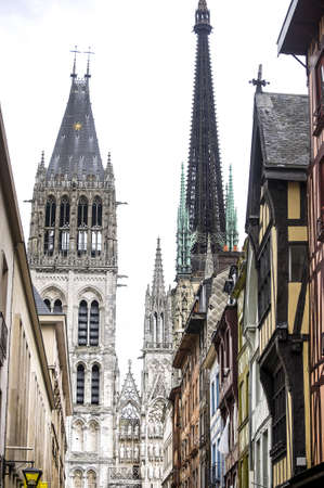Rouen (Seine-Maritime, Haute-Normandie, France) - Exterior of the cathedral, in gothic style, and half-timbered houses photo