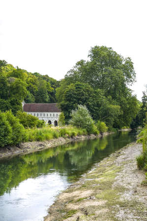 Ruins of the ancient Fontaine-Guérard abbey (Normandy, France), and river photo