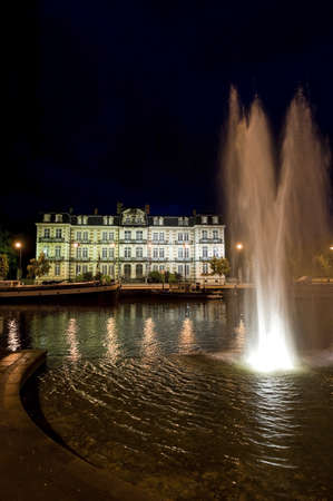 meuse: Ancient palace in Verdun (Meuse, Lorraine, France) on the river at night