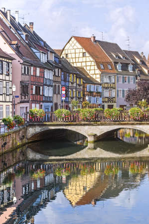 Colmar (Haut-Rhin, Alsace, France) - Exterior of old half-timbered houses, bridge and canal in the Petite Venise